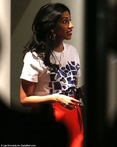 Back in action: Huma Abedin sported a sweeping red dress, a Jason Wu T-shirt and no wedding ring at the Hillary Clinton fundraiser she organized with Vogue's Anna Wintour Tuesday