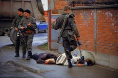 The First Day of Bosnian Genocide, 31 March 1992. Serb forces hunt down and kill Bosniak civilians in the city of Bijeljina. (Credit: Ron Haviv, Blood and Honey: A Balkan War Journal).  The Serbian paramilitary unit was responsible for killing thousands of people during the Bosnian war.
