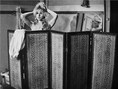 Brigitte Bardot behind a folding screen