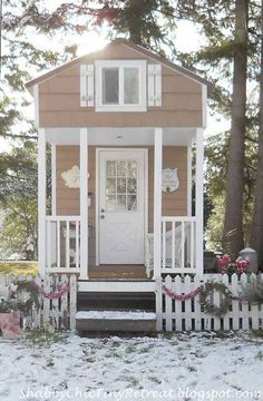White Picket Fence Decorated with Wreaths and Garland for a Cottage Home via Between Naps on the Porch