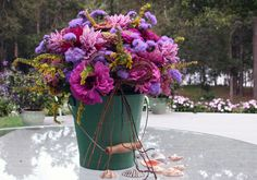 Creating flower arrangements for an outdoor wedding that has a sense of place.