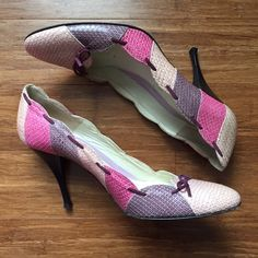 Amalfi leather heels sz 11. Pink & purple! Pretty! Amalfi leather heels. Size: 11. Heel: 4 inches. Pink & purple patchwork detail. Genuine leather. Bow at toe. Black heel. Purchased at Nordstrom. Pretty! Great preowned condition. Amalfi Shoes Heels