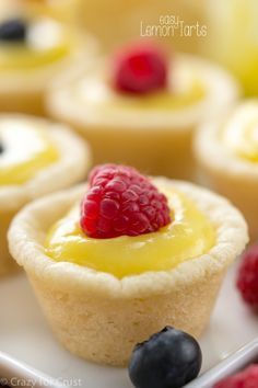 Easy Lemon Tarts with only 3 ingredients! Sugar cookie dough, lemon curd and fresh fruit (or lemon zest). Lemon Dessert Recipes, Lemon Recipes, Pie Recipes, Cookie Recipes, Mini Desserts, Just Desserts, Plated Desserts, Tea Party Desserts, Refrigerated Cookie Dough
