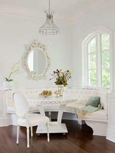 This semicircular bench adds elegance to this feminine kitchen. More built-in banquette ideas: http://www.bhg.com/kitchen/eat-in-kitchen/built-in-banquette-ideas/?socsrc=bhgpin081513femininebanquette=10