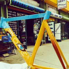 Beautiful yellow and blue paint job with eyes on this Throne bike frame.