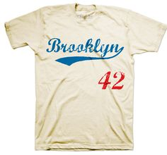 T-Shirt Brooklyn Classic #42  Over 60 years ago Jackie Robinson stepped onto Ebbets field and became the first African American to play baseball in the major leagues. We pay tribute to Jackie with this classic Brooklyn tee bearing his retired number forty two.  All t-shirt are screen printed by hand using soft to the touch inks. 100% Combed Ring spun Cotton. Super-soft, lightweight, slim-fit tee. Machine washable and preshrunk to minimize shrinkage.