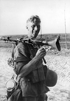 Happy looking Machine gunner. Looks much older than he actually is.