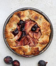 Warm spices and caramel-sweet brown sugar are a perfect marriage for juicy pears and tender, ripe figs in this stunning pie. A rustic fold-over crust not only looks lovely—it's also a technique that's simple enough for even non-crafty bakers to get right.