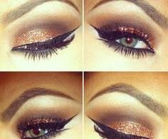 Gold eye shadow.