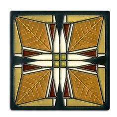 This tile is adapted from Frank Lloyd Wrights art glass design in one of three vestibule ceiling light fixtures in the Frank Thomas House. Built in Oak Park, Illinois, in 1901, the Thomas House holds