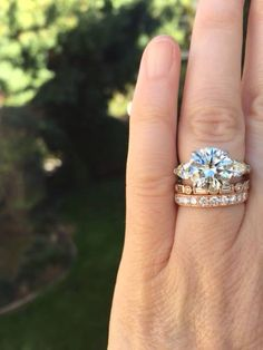 Diamond three stone ring with fantastic rose gold and diamond bands by David Klass Jewelry.