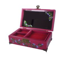 Amethyst purple roses adorn the top this hand-painted jewelry box, against a deep rose pink background. A coordinating border of rose buds