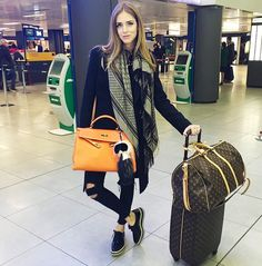 Chiara Ferragni of The Blonde Salad in black skinny jeans, a printed scarf, and oxfords
