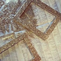 I could $ store and thrift shop frames in different styles and glitter blast in gold silver and white for the pictures/fun facts