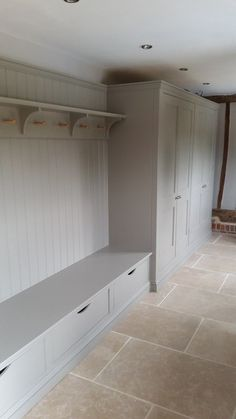 Bespoke boot room near Bishops Stortford on the Essex/Herts border. Bespoke boot room near Bishops Stortford on the Essex/Herts border. Clothes pegs in maple. Internals of cupboard and Laundry Mud Room, Home, Boot Room, New Homes, House, Kitchen Cabinet Storage, Shoe Room, Utility Rooms, Mudroom