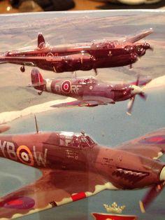 The best British fighters Spitfires escorting British Lancaster bomber.