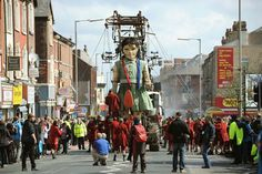 The Sea Odyssey moves along Breck Road, Anfield as crowds cheer on the Little Girl Giant