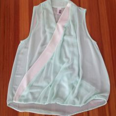 Mint green and white sheer cross over top Francesca's mint green sheer cross over top. Looks great with a white bandeau underneath, or you can show some cleavage. Drapes beautifully! Francesca's Collections Tops Blouses