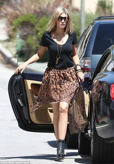 Take a walk on the wild side: Delta Goodrem looked superb as she showed off her legs in a short leopard skin print skirt in Los Angeles on Thursday