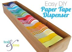 diy paper tape dispenser...a tension rod inside a repurposed bamboo drawer storage box...Brilliant!!  Could also use the same system to hold crafting ribbons!!  LOVE IT!!