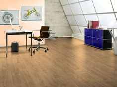 The Elf Oak Linero laminated wooden floor has a beautiful color which blends in well with most furniture colors. Laminated flooring is warm in winter and cool in summer. This laminate is perfect for studies, m Wood Laminate Flooring, Colorful Furniture, Tile Floor, Comfy, Warm, Cool Stuff, Table, Home Decor, Decoration Home