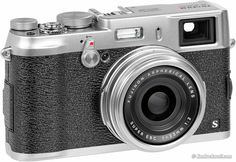 The Fuji x100s  A 35mm equivalent lens with an APS-C 16MP sensor. A great digital rangefinder that features a hybrid electronic and optical viewfinder.