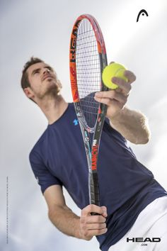 Andy Murray on court serving with new Head Radical