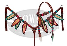 This beautiful Showman LIMITED EDITION Painted Feather set features teal and pink hand painted feathers on medium leather and is accented with antique bronze Conchos with colored crystal rhinestones a