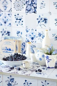 Blue/white tiles Handmade tiles can be colour coordianated and customized re. shape, texture, pattern, etc. by ceramic design studios