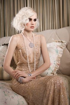 Vintage inspired layered pearls and pendant necklace. Paired with a beautiful designer gown and 20s inspired flapper hair