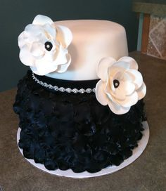 Black and White Birthday Cake - 2 Tier Petal Cake - Two Tier black and white birthday cake. Bottom tier is covered in fondant petals and top is adorned with gum paste flowers and a little bling.