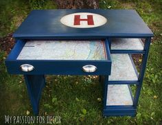The shelves and drawer  are decoupaged with vintage gas station maps.
