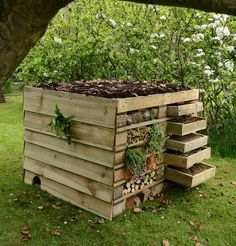 wildlife house by bug storeys ltd | notonthehighstreet.com I love the little details in this one, especially the hedgehog hole at the bottom and the drawers which can be taken out to show groups of children.
