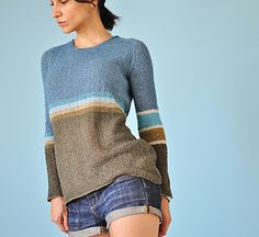 The loose fitting Pullover with overall texture in two different stitch patterns proposes variation in colour blocking and graded striping.