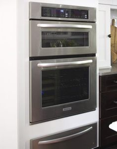 Space Savers  Save space with a stack of KitchenAid cooking appliances clustered together on one wall. This group includes a convention microwave oven, a steam-assist oven, and a warming drawer.