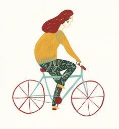 Una chica que anda en bici.