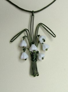 bunch of snowdrops necklace. green wire. white glass flowers.