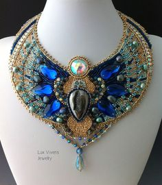This beautiful Egyptian themed collar necklace is a contemporary crystal version of traditional Egyptian collar jewelry.  A modern color palette