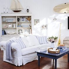 If you are looking to create a relaxed seaside retreat then a palette of blues and whites mixed ba...