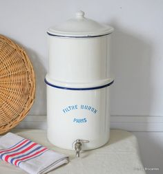 Rare and fabulous French enamel water filtering pot made by Filtre Buron in Paris. When in use, the top pot is filled with water and is filtered down through a ceramic stone filter to the lower pot. Water is then 'served' through the small spigot at the bottom.