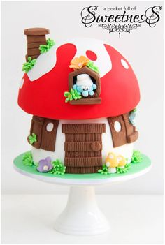 Smurf mushroom cake created by A Pocket Full of Sweetness- This is adorable!