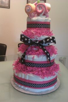 Diaper Cake I made for a Baby Shower! This is a result of YouTube, about an 1 1/2 hours of my time, and under 50 dollars can make :)