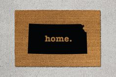 Kansas State Silhouette Natural Coir Door Mat  This hand-decorated, one-of-a-kind door mat is the perfect accent to any entryway. Made with resilient and renewable coconut fibers, our doormats effectively whisk away debris from shoes while also also featuring a beautiful design to greet your guests.  MATERIALS AND CRAFTSMANSHIP • Every single door mat is made-to-order and unique • Made with renewable coconut fibers that are both resilient and beautiful • Every mat features a latex, non-skid…