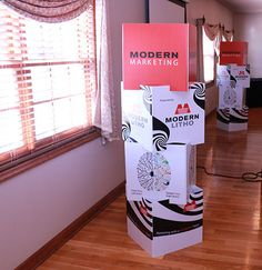 LOOKING FOR A UNIQUE EVENT MARKETING PIECE? TRY STACKING CUBES!  Stacking cubes add a customized, dimensional feature to any space. These are great for lobbies, event marketing, trade show booths, anywhere you want to make a statement. Printed using wide format technology on Coroplast (corrugated plastic sheets) or flat cardboard sheets, they are durable and collapsible for easy transport.