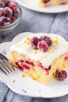 A deliciously moist Cranberry Orange Cake with Cream Cheese Frosting. Bursting with oranges & dotted with cranberries - this is the perfect holiday cake