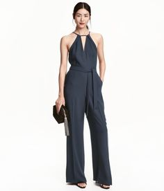 A navy jumpsuit that will essentially elevate you to the same level as your…