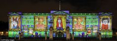 Buckingham Palace. A projection of portraits of the Queen made by children on the front of the palace.