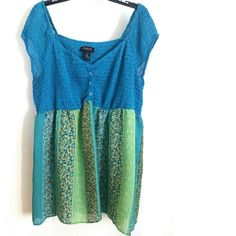 "Lane Bryant 22/24 Blue & Green Smocked Tunic Top This Lane Bryant 22/24 Blue & Green Smocked Tunic Top is in gently used condition. Made of two fabrics, it is smocked and stretchy on the top, with pretty chiffon on the bottom. Bust measures 23.5"" across laying flat, measured from pit to pit, so 47"" around unstretched--and has a lot of stretch. 33"" long. No rip, stains, tears, or pilling; no smoking home. ::: Bundle 3+ items from my closet and save 30% off when you use the app's Bundle…"