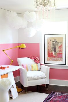 Love so many things...mixed wall color, chandelier, white pom poms, chair with flooring...