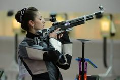 Syria's Raya Zin Aldden competes in the 10m air rifle women's qualification at the Royal Artillery Barracks in London. The first gold of the Olympics was be decided at the Royal Artillery Barracks where China's world number one Yi Siling won the women's 10m air rifle.